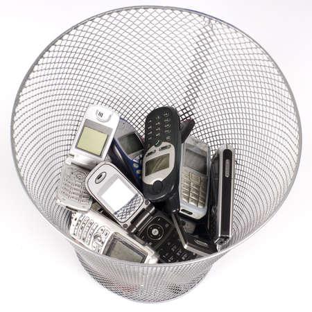 wastepaper basket: old cellphones in the wastepaper basket