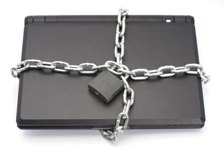 upperdeck view: Closed laptop wrapped around with metal chain and locked with padlock shot over white