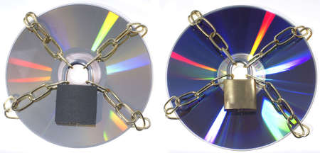 Two DVD disks with chains and a padlock. Isolated on a white background photo