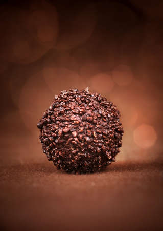 Chocolate ball in beautiful brown background
