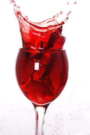 Red wine splashing out of a glass  photo