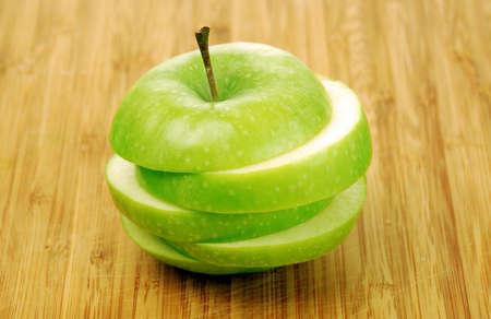 sweet segments: Green apple on table Stock Photo