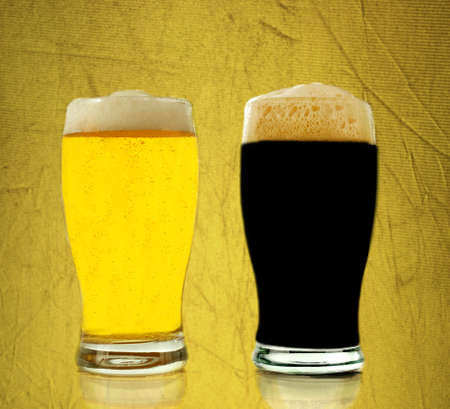 Gold and black beer in gold textured background photo