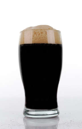 Brown beer glass in white background