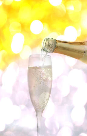 Champagne bottle with glass in abstract background Stock Photo - 9221306