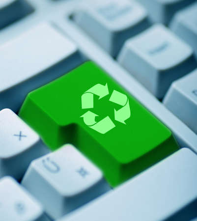 Recycle signs on gray keyboard photo