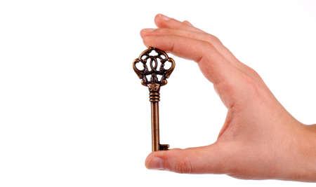 Hand holding a key in white background Stock Photo - 9277601