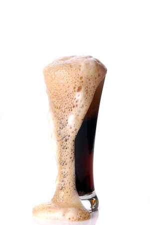 dark beer: Glass of dark beer with froth in white background