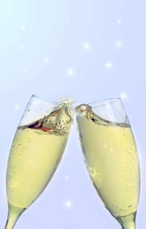 Two champagne glass in abstract background photo