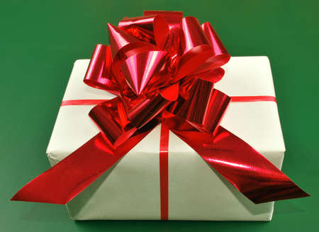 Gift box on green background Stock Photo - 11674429