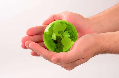 Glass globe in human hand