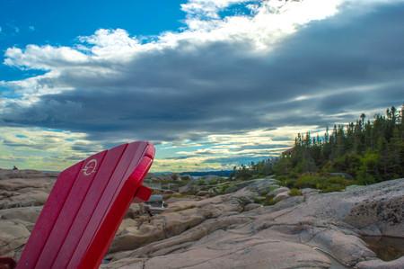 shore: Sea shore Canada Red chairs Stock Photo