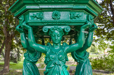 fontaine: Montreal, Canada - June 14, 2015: Close-up of Fontaine Wallace - 1871 by Charles-Auguste Lebourg 1829-1906 - cast iron - Parc Jean-Drapeau - le Notre-Dame Editorial