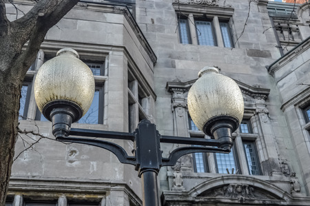 crux: The street light in front of the old building in Montreal downtown Stock Photo