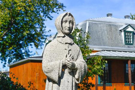 Mercier, Canada- 27 August, 2015: Statue of a Nun in Mercier, Canada.
