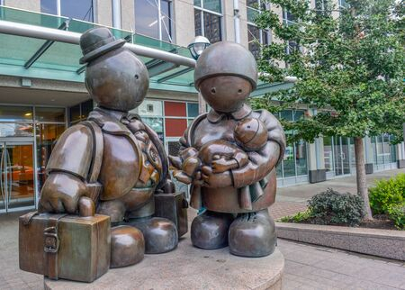 immigrant: The bronze Immigrant Family sculpture by Tom Otterness on Yonge Street.