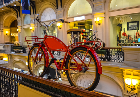 view of an atrium in a building: Moscow, Russia - April 10, 2015: View of the galleries the second and third floors in the State Department Store GUM with the red bike.