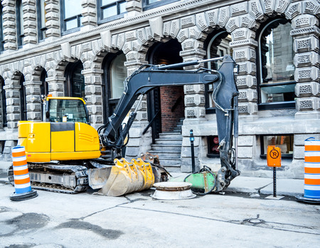 old port: Small excavator in old port, Montreal Stock Photo