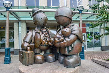 immigrant: Toronto, Canada - August 15,2015: The bronze Immigrant Family sculpture by Tom Otterness on Yonge Street.