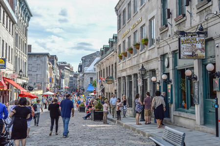 people: Montreal, Canada - June 6, 2016: Popular St Paul street in the Old Port. People can be seen around. Editorial