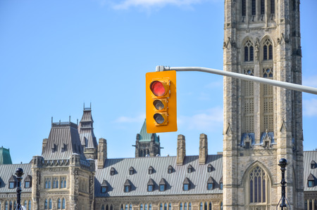 traffic controller: Red color on the traffic light in Ottawa downtown.