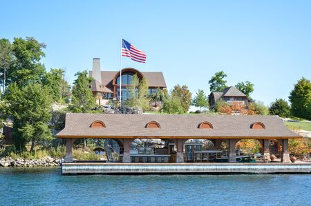 Kingston, Canada - September 3, 2016: One Island with the white house in Thousand Islands Region in summer in Kingston, Ontario, Canada
