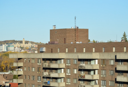 St Joseph Oratory behind the roof of the residential building in fall in Montreal (Canada)