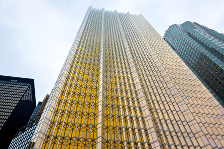Toronto, Canada - November 16, 2016: Facade of gold and black glass skyscrapers in Toronto downtown at low angle