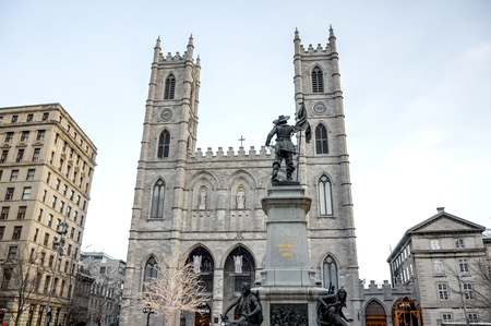 Basilica Notre Dame with statue of Paul de Chomedey de Maisonneuve, founder of Montreal. In Old Town, Montreal, Canada.