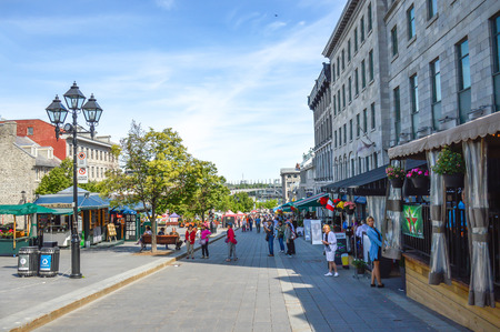 Montreal, Canada - June 15, 2017: Tourists on Jacques Cartier place.Place Jacques-Cartier is a square located in Old Montreal and an entrance to the Old Port of Montreal. People can be seen around. Publikacyjne