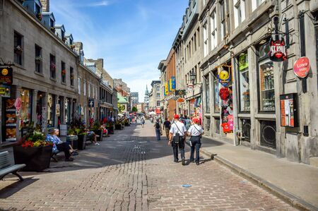 Montreal, Canada - June 15, 2017: Popular St Paul street in the Old Port. People can be seen around.