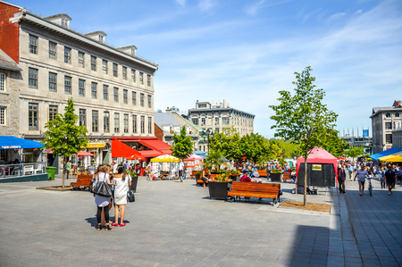 Montreal, Canada - June 15, 2017: Tourists on Jacques Cartier place.Place Jacques-Cartier is a square located in Old Montreal and an entrance to the Old Port of Montreal. People can be seen around. Editorial