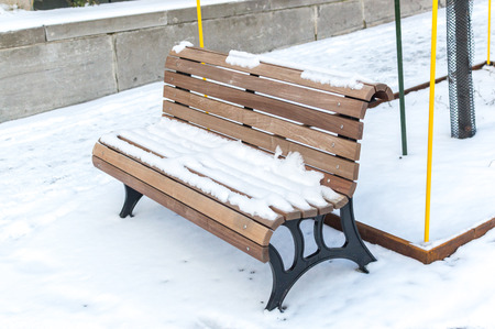 The bench covered with the snow in Montreal, Canada Stock Photo