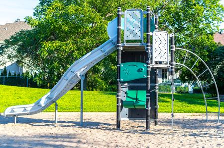 Modern children playground in park in Canada Stock Photo