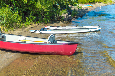 Group of canoes and kayaks on a lake shore in park, Canada. 写真素材