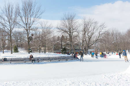 Montreal, Canada - February 16, 2020: Ice skating rink at Beaver Lake - Mount Royal Park, Montreal, Quebec, Canada (Lac des Castors - Parc Mont Royal, Montral, Qubec, Canada)