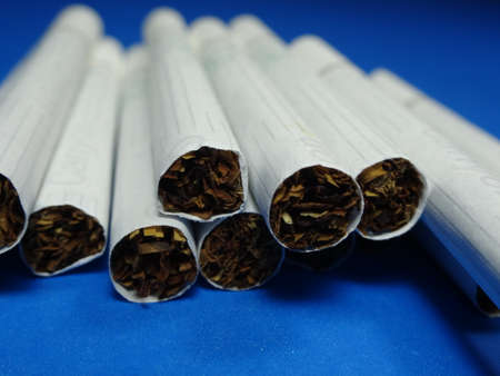 menthol: bunch of menthol cigarettes on blue background Stock Photo