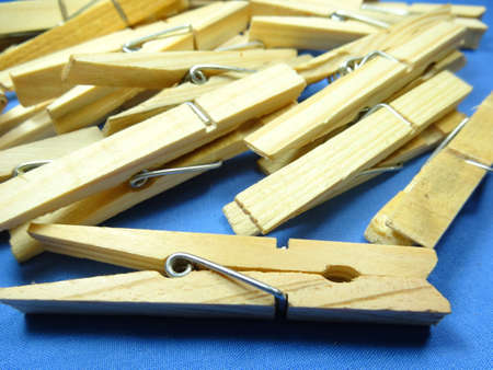 household objects equipment: wooden peg on blue background Stock Photo