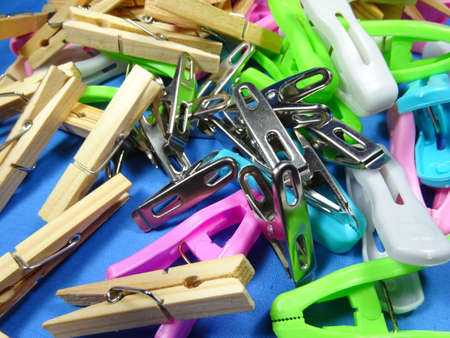 household objects equipment: colourful peg on blue background