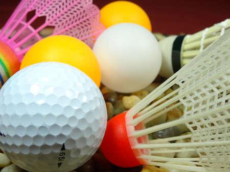 balones deportivos: bolas de deportes en el fondo de piedra de r�o Foto de archivo