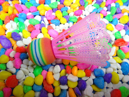 south east asia: colourfull plastic shuttlecock in colourful stone background. Photo taken in Malaysia, south east asia