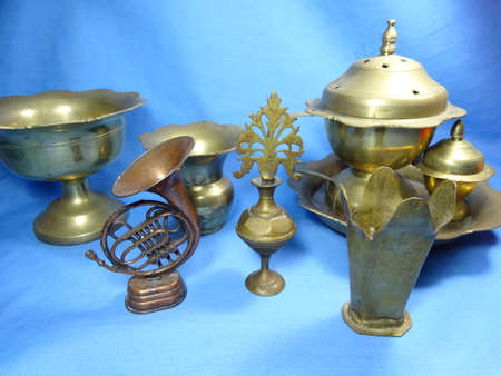 bronze bowl: Malaysian antique equipment and utensil on blue background Stock Photo