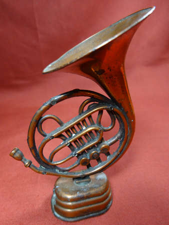 trombone: Malaysian antique small decoration trombone on brown background Stock Photo