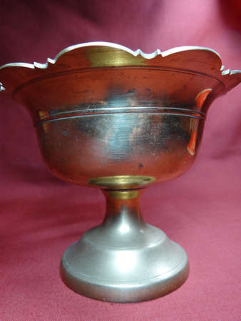 bronze bowl: Malaysian antique hand washer bowl on brown background Stock Photo