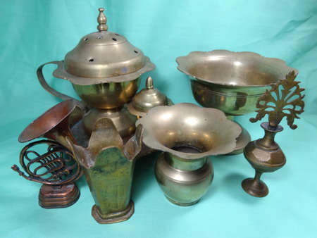 bronze bowl: Malaysian antique equipment and utensil on light green background