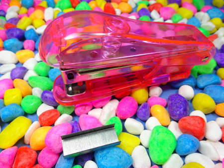 staplers: A pink stapler in colourful stone background