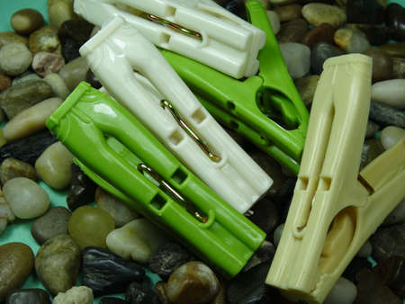 household objects equipment: pegs on river stone  background Stock Photo