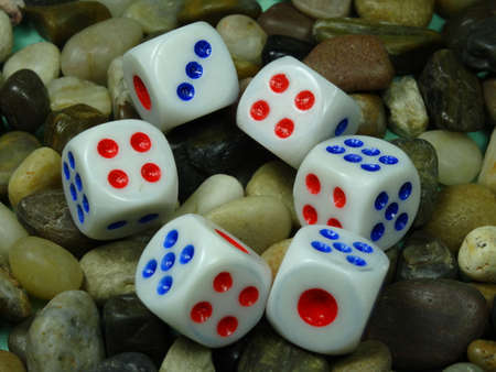 gambling stone: dices  on river stone background