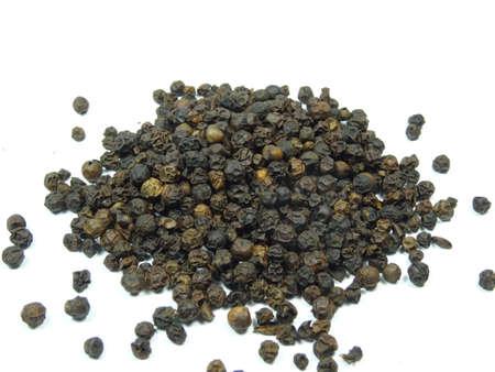 scattered on white background: black pepper scattered in white background, photo taken in Malaysia