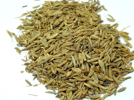 scattered on white background: Caraway or Cumin Parsi scattered in white background, photo taken in Malaysia Stock Photo